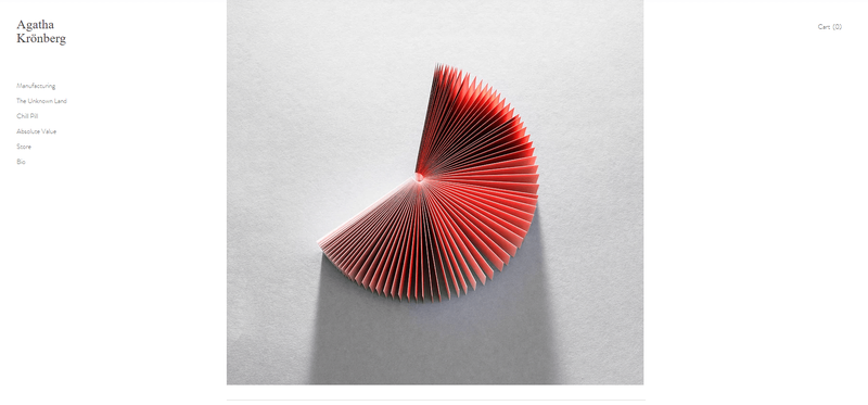 A Modern Artist template homepage with small, light text on the left-hand side and a large central image of a red fan.