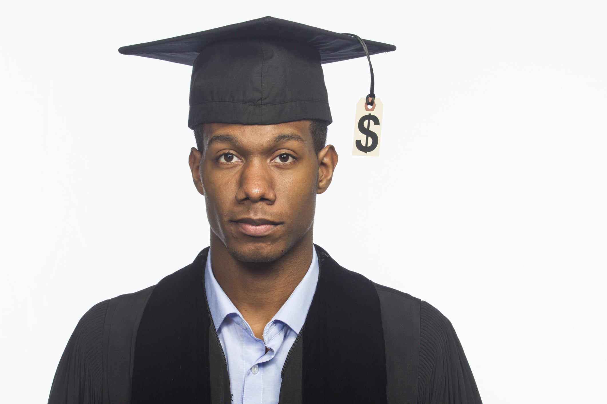 College graduate with dollar sign hanging from the tassel of his hat.