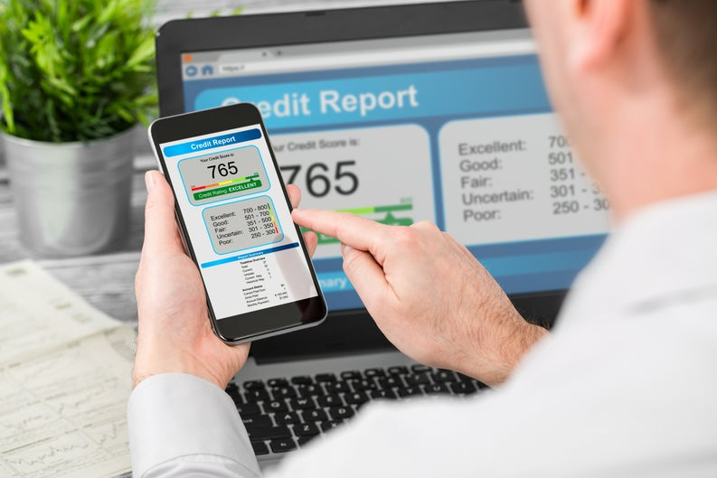 Man Viewing Credit Score On Smartphone