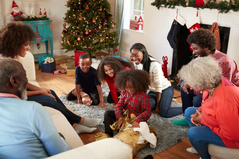 A family opening gifts on Christmas morning.