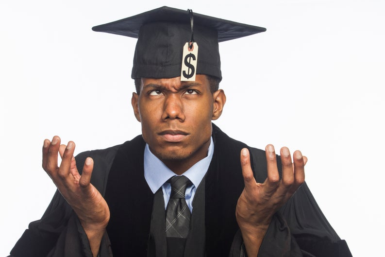 Graduate in cap and gown looking up in fraught confusion at dollar-sign tag dangling from tassel.