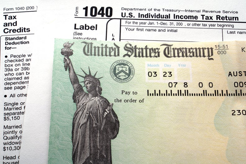 A tax check on top of tax forms.