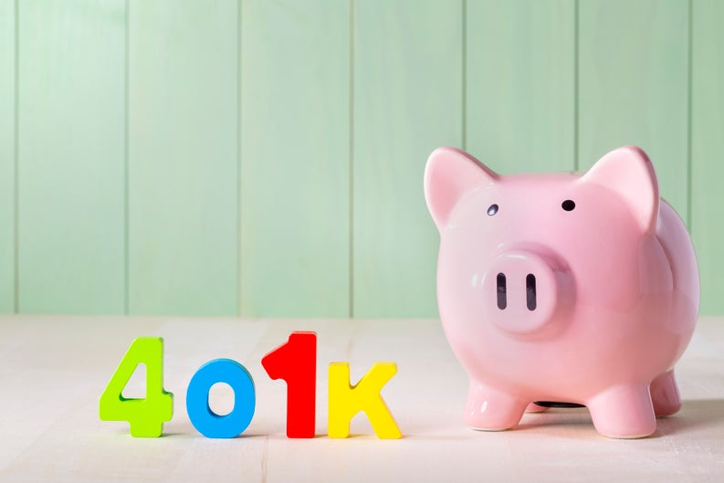 Colorful letters spelling out 401(k) next to a piggy bank.