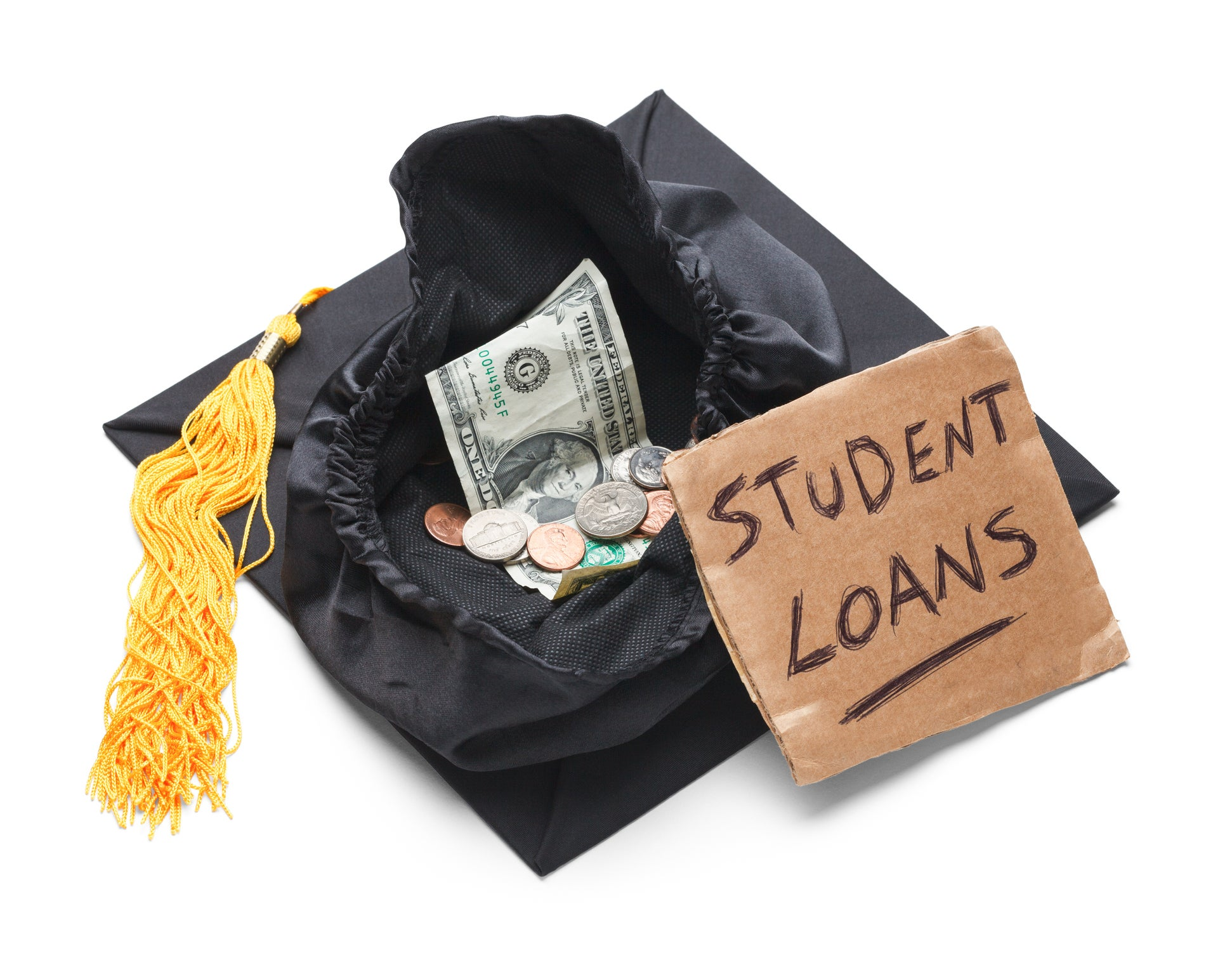 Sign reading student loans next to a graduation cap filled with loose change